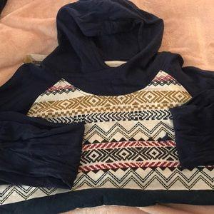 In good condition. Long sleeve hoodie tee